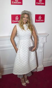 Kitty Spencer finished off her outfit with a silver glitter clutch.