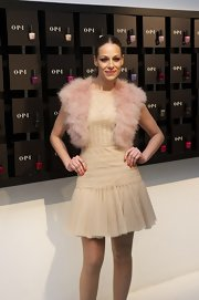 Eva Gonzales wore a fab fur vest as an accent to her pretty dress.