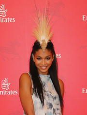 Chanel Iman attended Stakes Day rocking a sky-high, feathery headpiece.