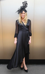 Alexandra Richards topped off her  black satin gown with patent leather peep-toe pumps.