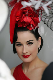 To recreate Dita's lovely look, we recommend a product like Benefit Smokin' Eyes, a kit that comes with all you need for creating a sexy eye makeup look plus two products for creating perfect brows. A neutral shadow adds definition to creases while a deep gunmetal gray powder is perfect for use as an eyeliner. For even more drama, black liquid liner can also be swept across the upper lash lines.