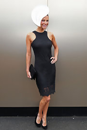 Esther Anderson accessorized her figure-flatting black lace dress with classic black pumps.