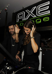 Nikki had some fun on the turntables wearing a navy ensemble with a gold link watch.