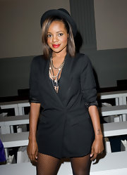 Keisha dressed up her bold blazer with a chic top hat while attending London fashion week.