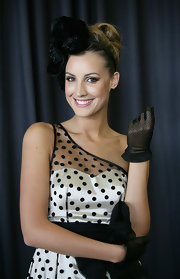 Laura Dundovic paired black lace gloves with her polka-dot dress for a charming retro look during Golden Slipper Day.