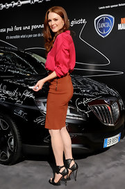 Julianne Moore looked stunning in towering black Lanvin heels from the Spring 2011 collection. She paired the heels with a burnt orange skirt and fuchsia blouse.
