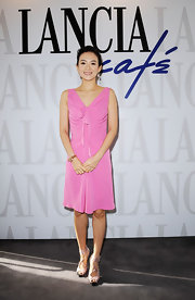 Zhang Ziyi paired her bubblegum pink frock at the Lancia Cafe with intricate strappy sandals complete with ankle straps.