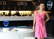 Zhang Ziyi wore a sweet pink cocktail dress with a bowed bust and gathered bodice at the Lancia Cafe.