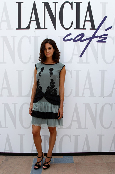 Asia Argento donned a powder blue dress with black lace detailing and a tiered fringe hemline. She finished off the look with strappy black heels.
