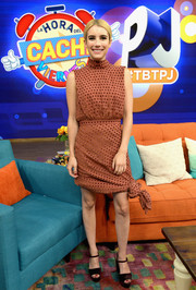 Emma Roberts donned a high-neck polka-dot mini dress with a knotted hem for her appearance on 'Despierta America.'