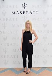 Dakota nailed the cool and contemporary look when she opted for this black halter jumpsuit.