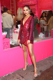 Olivia Culpo brought major shimmer to the launch of Beautyblender Bounce Liquid Whip Foundation with this sequined wrap dress by Retrofete.