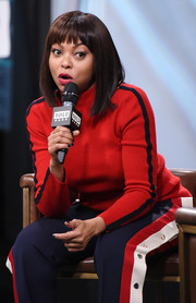 Taraji P. Henson stayed cozy in a red turtleneck and sporty pants while visiting Build.