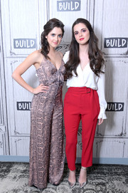 Laura Marano visited Build wearing a mauve snakeskin-print jumpsuit.