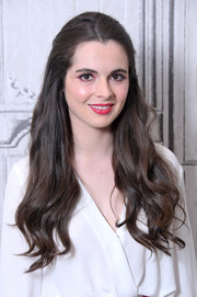 Vanessa Marano styled her lock locks into a half updo for her visit to Build.