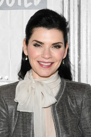 Julianna Margulies visited Build wearing her hair in a simple and demure half-up style.