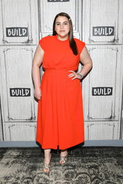 Beanie Feldstein styled her look with gold knot-detail mules.