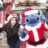 "In this handout image provided by Disney, Selena Gomez meets ""Santa"" Stitch at Sleeping Beauty Winter Castle at Disneyland on November 7, 2009 in Anaheim, California. The meeting took place while taping a segment for the 2009 Disney Parks Christmas Day Parade airing December 25, 2009 on ABC ."