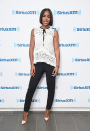 Kelly Rowland was casual yet sweet in a sleeveless white lace blouse while visiting SiriusXM.