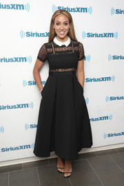 Melissa Gorga looked adorably chic in a lace-bodice LBD with a contrast collar while visiting SiriusXM.