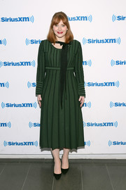Bryce Dallas Howard donned a long-sleeve forest-green midi dress for her visit to SiriusXM.