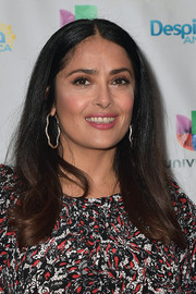 Salma Hayek added a dose of glamour with a pair of diamond hoops by Gilan.