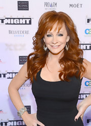 Reba McEntire showed off her signature fiery locks with this long and wavy 'do with wispy bangs.