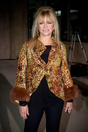Jo Wood likes to dress up her black basics with statement outerwear like this velvet print fur cuffed coat.