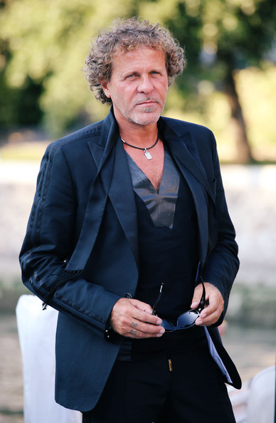 Renzo Rosso sported a sophisticated all-black ensemble at the Venice Film Festival, topped off with a satin-trimmed tux.