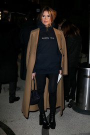 For her shoes, Miroslava Duma chose a pair of chunky black platform boots.