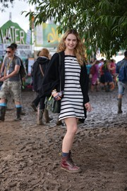 Lily James looked breezy in a black-and-white striped mini by Kate Spade New York during the Glastonbury Festival.