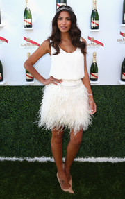 Pia Miller went for a fun and chic 1920s vibe during Melbourne Cup Day in a white Johanna Johnson cocktail dress featuring a feathered skirt.