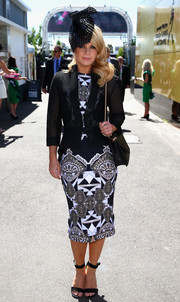 Emma Freedman teamed a fitted black mesh jacket with a geometric-print dress for her Melbourne Cup Day look.