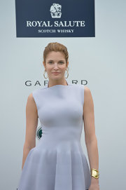 Stephanie Seymour added subtle glamour to her look with a gold cuff bracelet at the Sentebale Royal Salute Polo Cup.