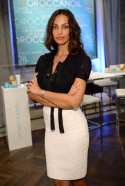 Madalina Diana Ghenea showed off her shapely physique in a textured white pencil skirt teamed with a fitted black blouse.
