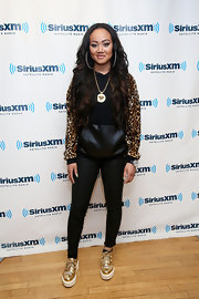 Cymphonique Miller chose a leather and leopard-print hoodie for her edgy look at the Sirius XM Studios.