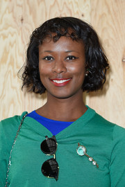 Shala Monroque adorned her green sweater with a crystal pin for a chicer finish.