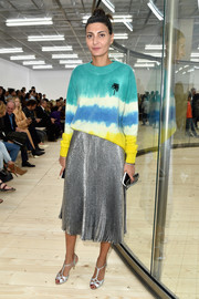 Giovanna Battaglia arrived for the Celine fashion show looking bright in a tie-dye crewneck sweater.