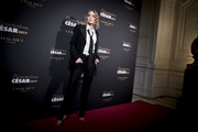 Lily-Rose Depp went mannish in a black Chanel suit for the 'Cesar Revelations 2017 photocall.