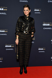 Marion Cotillard teamed her top with grid-patterned trousers, also by Chanel.