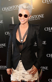 The platinum beauty donned a pair of retro round sunglasses to complete her look.