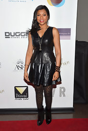 Tarji P. Henson's black leather skirt gave her leather look a bit of a feminine touch.