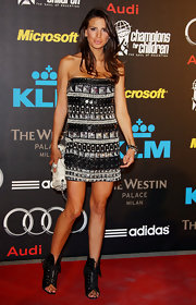 Claudia attended a gala in Milan wearing a beaded dress with fun horizontal patterns.