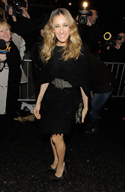 Sarah Jessica Parker paired her black belted dress with matching satin platform pumps.