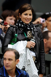 Mirka Federer's polka dot scarf was an adorable addition to her leather jacket.
