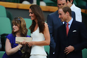 Kate Middleton was simple and chic at Wimbledon in a white pleated frock paired with a nude patent leather clutch.