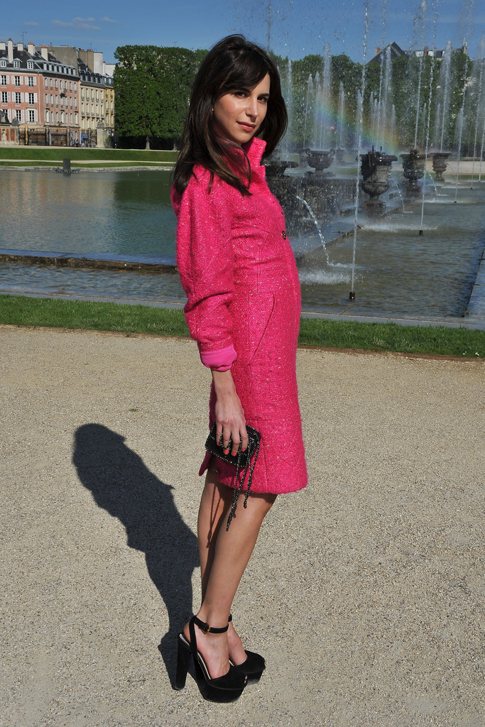Caroline Sieber poses during the Chanel 2012/13 Cruise Collection Photocall at Chateau de Versailles on May 14, 2012 in Versailles, France.