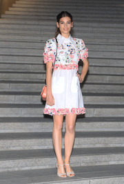 Alma Jodorowsky looked sweet and youthful in a flower-appliqued mini dress by Chanel during the label's Cruise show.