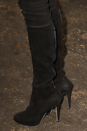 Diane Kruger pulled on a pair of black suede over-the-knee boots before heading to Chanel's couture show.