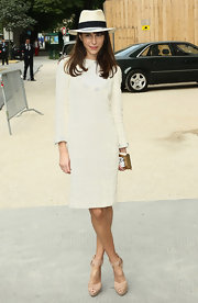 Caroline looked pristine in her white tweed dress at the Chanel Haute Couture show in Paris.